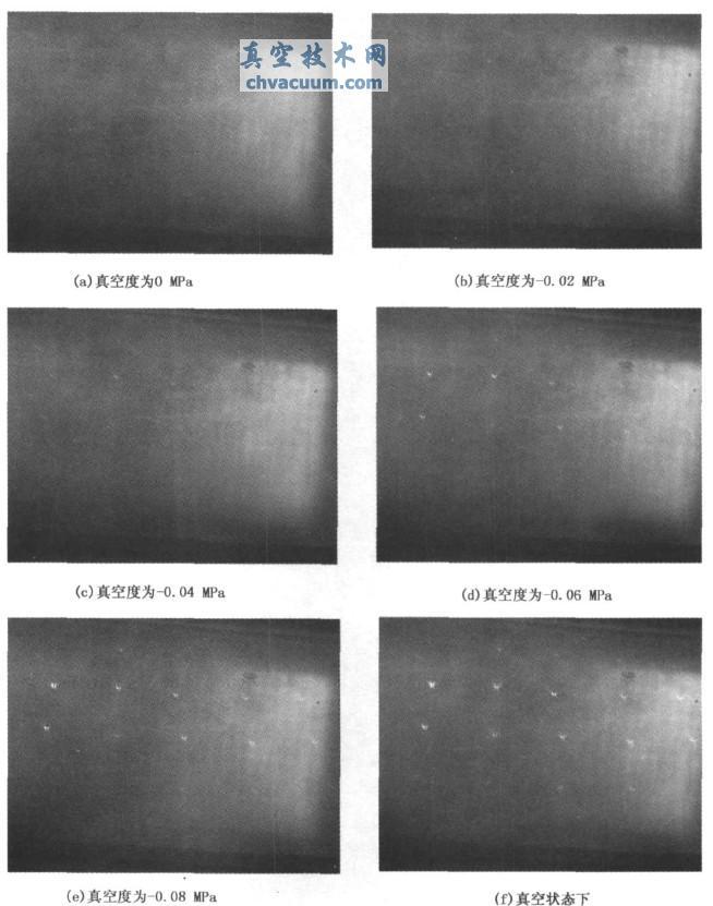 通过光弹仪观测到真空玻璃应力光斑图